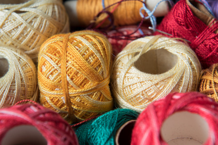 Group of sewing threads as background or wallpaper, yellow sewing thread 版權商用圖片