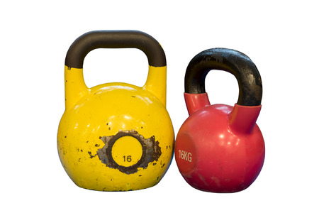 Red and yellow used and old kettlebells isolated on a white background. Workout equipment