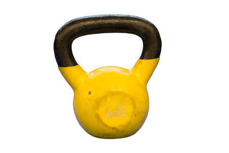 Small yellow eight kilograms heavy worn out kettlebell isolated on a white background