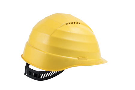 Used Yellow safety helmet isolated on white background. Clipping path saved. Protection helmet, construction equipment. Yellow hard helmet Stock Photo