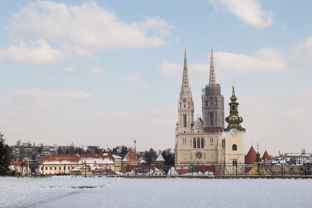 Zagreb Cathedral and city skyline during winter and snow as seen from Gradec, Zagreb, Croatia. 写真素材