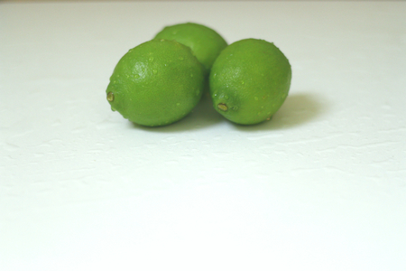 Beautiful, whole,organic limes just washed and isolated shot.