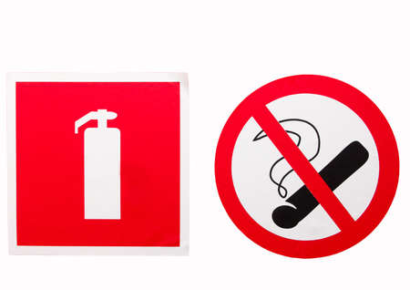 no smoking sign and a fire extinguisher on the wall photo