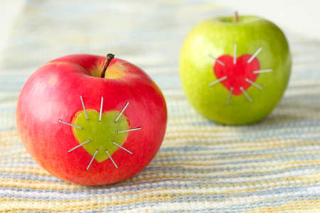 green and red apple with a heart symbol photo