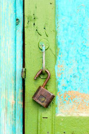 Old �astle hangs on a shabby door photo