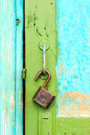 Old �astle hangs on a shabby door Stock Photo - 14419868