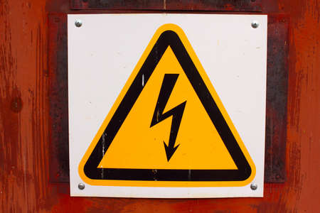sign warns of the danger of high voltage photo