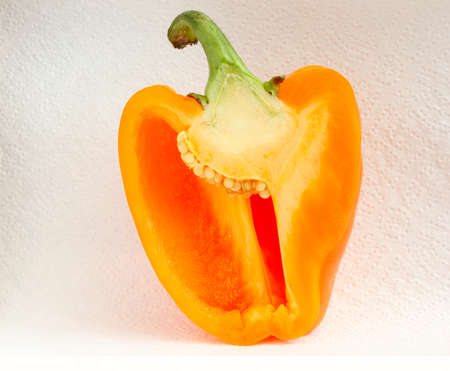 half of sweet pepper  on white background