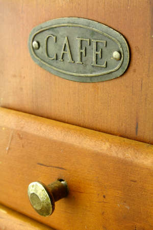 old coffee grinder brown in color Banque d'images