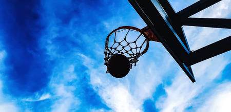 basketball hoop and ball on the sky background Stock Photo