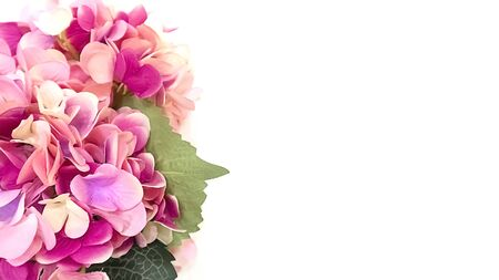 Huge bunch of colorful large spring flowers to the left on the image on a white background. Postcard. St. Valentine's Day, International Women's Day, birthday, holiday concept, copy space