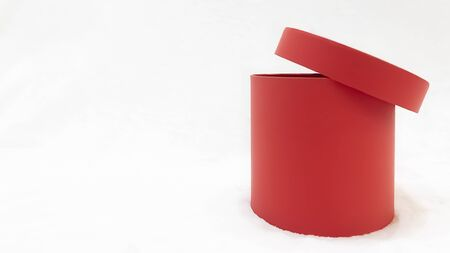 Red open gift box cylindrical shape on white background, copy space. St. Valentine's Day, International Women's Day, birthday, holiday concept. Mock up Archivio Fotografico