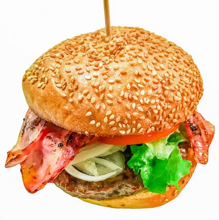 Burger on white background. Big juicy Burger with bacon and sesame bun. Close-up. Isolate Archivio Fotografico