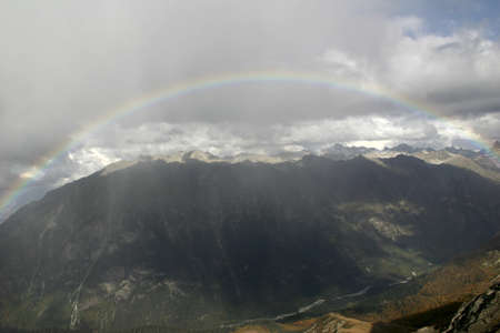 a beautiful rainbow in the mountains photo