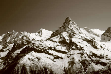 The white tops of the mountains in summer, black and white and grayscale images. Stock Photo - 11560667