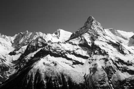 The white tops of the mountains in summer, black and white and grayscale images. Stock Photo - 11560664