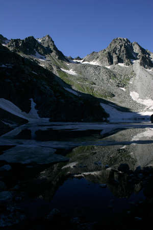 Alpine Lake Alpine latitudes at different times of the year Stock Photo - 11560702