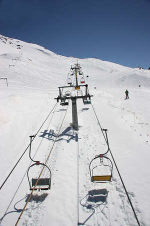 vacationer: Winter mountains on a sunny day, the resorts of the Caucasus