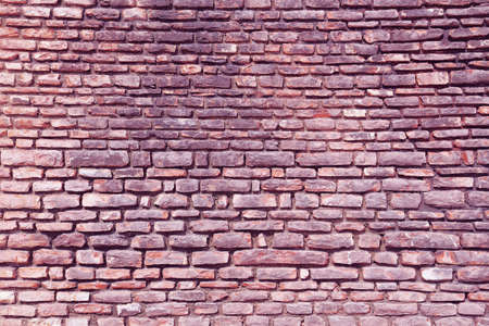 The city wall of stone in violet tint photo