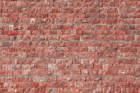 The city wall of stone in red tint photo