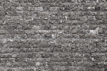 The city wall of stone in gray tint photo