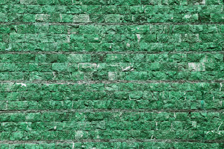 The city wall of stone in green tint photo