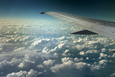 View from window of a jet plane wing with beautiful weather