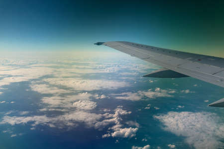 View from window of a jet plane wing with beautiful weather photo