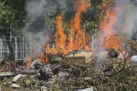 Illegal burning of waste in violation of environmental norms Stock Photo - 21642797
