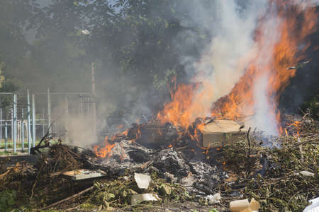 defilement: Illegal burning of waste in violation of environmental norms