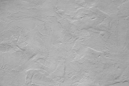 white background, lime plaster wall with scratches and irregularities Archivio Fotografico