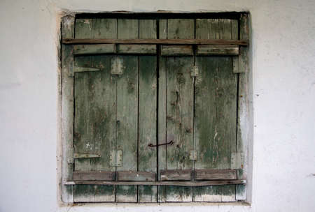 Old wooden shutters on the wall photo