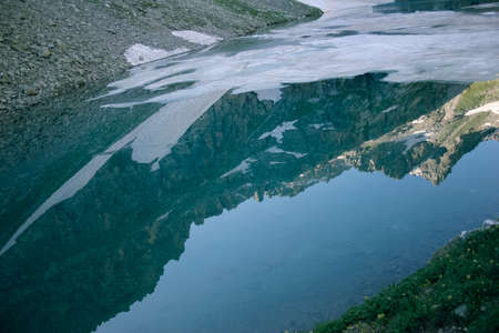 Pure mountain water. Mirroring the top of water.