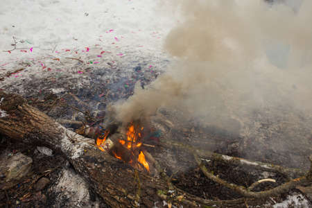 refuse: Refuse disposal in a fire in nature, cleaning and waste incineration after the picnic