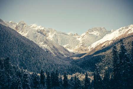ski slopes: Winter mountains panorama with ski slopes. Caucasus. Stock Photo