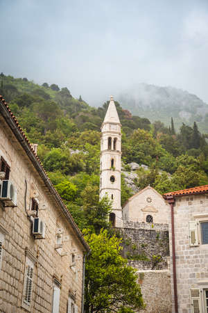 Ancient walls old town Boka Kotorska on the Adriatic Sea, Mediterranean Sea, Montenegro, Europe. Boka Kotorska - the medieval cities of the Venetian style in the Mediterranean
