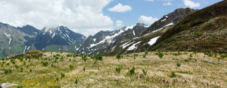 Mountains Landscape, tranquil idyllic reserved places, nature idyllic peak scene and alpine meadows. Soncept of travel, hiking and adventure.