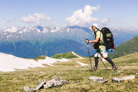 Man backpacker hiking in the rocky mountains alone outdoor active lifestyle travel adventure vacations. Landscape Travel Lifestyle success motivation concept active vacations outdoor.