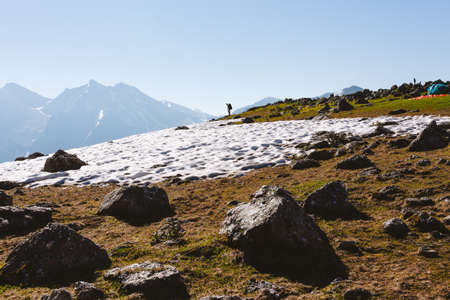 Man backpacker hiking in summit mountains. Hiking Traveling alone, healthy lifestyle active vacations trail running outdoor. Adventure traveling rocky mountains. Weekend vacations wild nature.
