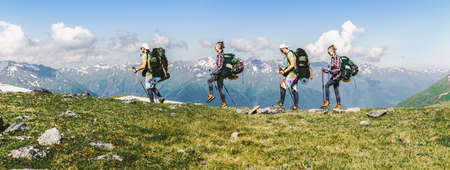Sports travel background photo collage group of people hipster friends extreme tourists with backpacks on top of mountain Lifestyle Adventure hiking or expedition concept the background of high peaks