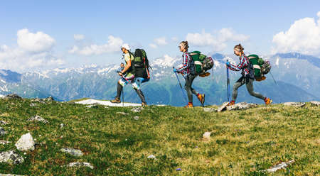 Sports travel background photo collage group of people hipster friends twins relatives extreme tourist with backpacks on top of mountain Lifestyle Adventure hiking or expedition concept the high peaks