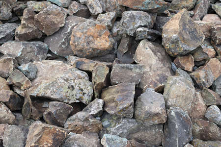 Gray gravel stones for the construction industry. Large Pile of Gray Boulder Rocks