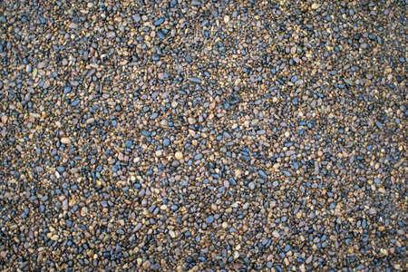 Small sea pebbles texture background, small coastal decorative stones. Archivio Fotografico