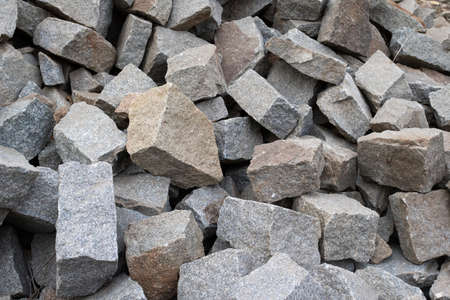 A large pile of boulder rocks. Stones for the construction industry. Stone background, gravel stone texture, granite.