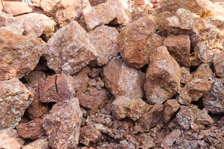 Texture of gravel stones on the ground, crushed stone, top view, the texture of gravel stones on the ground background.