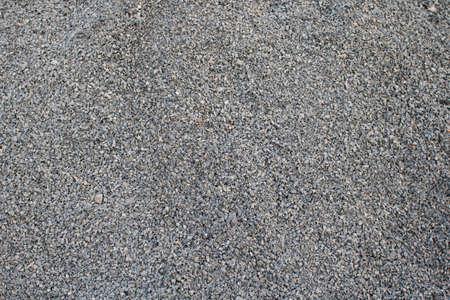 Gravel texture. Natural texture background. Fine light gray stone gravel.