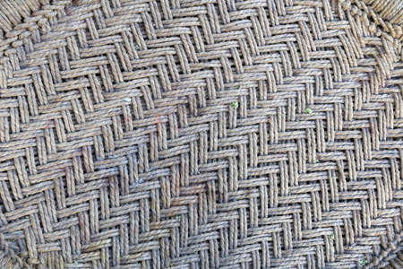 Handmade rug from date palm leaves. Date palm woven pattern. Handmade wicker bamboo. Straw palm rug. Abstract background texture wicker wall. Wicker rug made of dried palm leaves. Weaving bamboo.