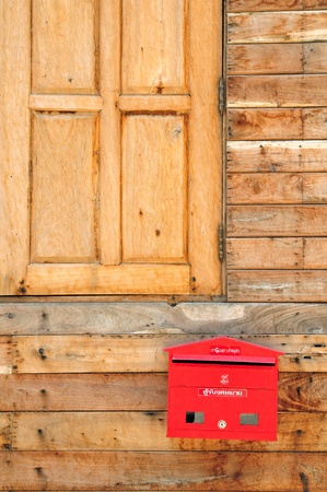 Red letter box outside my house. Stock Photo