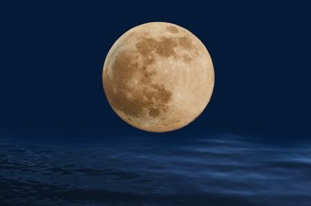 full moon over. the night sea