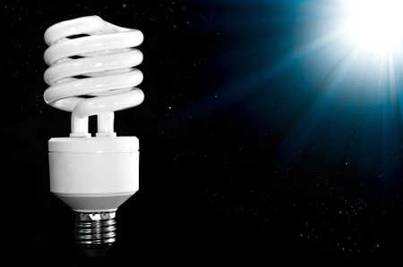 Energy saving lamp  on black background. photo